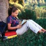 Girl reading at tree